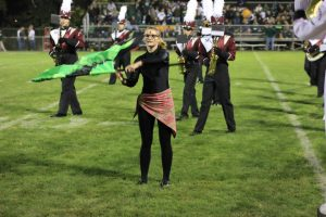 Renny Klein performs with the color guard at halftime Sept 13. Photo by Lexi Kelly.