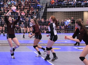 Junior Morgan Melchert sets the ball in game three against Sheldon in state quarterfinals, which the Mustangs won 25-21.