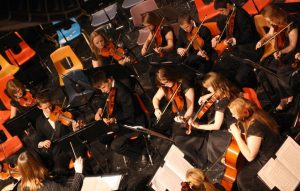 """The MVHS Orchestra performs """"Shenandoah"""" on Dec. 16 conducted by Tabitha Rasmussen. Photo/Sarah Boettcher."""