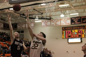 Tommy Hook goes up for a shot against Regina third quarter in the 2A District Final game against Regina.  Tommy scored 31 points, 20 in the first half. The Mustangs beat Regina, 73-63. Photo by Claire Pettinger.
