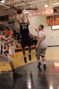 Connor Herrmann shoots a basket at district finals Tuesday.