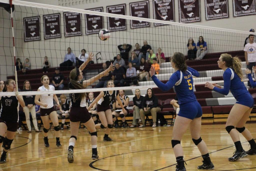 Mount Vernon's setter  Morgan Melchert dumps the ball against Benton Community at the first round of regionals on Monday night. Photo by Claire Pettinger.