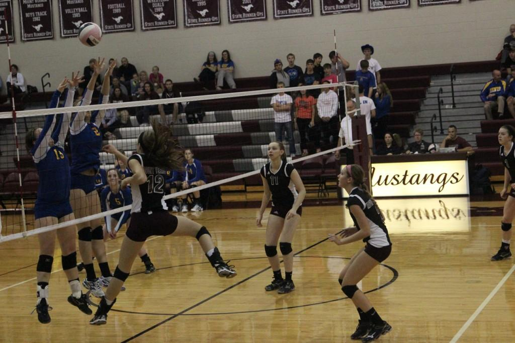 ​Emma Cochrane (12), attacks the ball in an attempt to save this intense play.  Photo by Claire Pettinger.