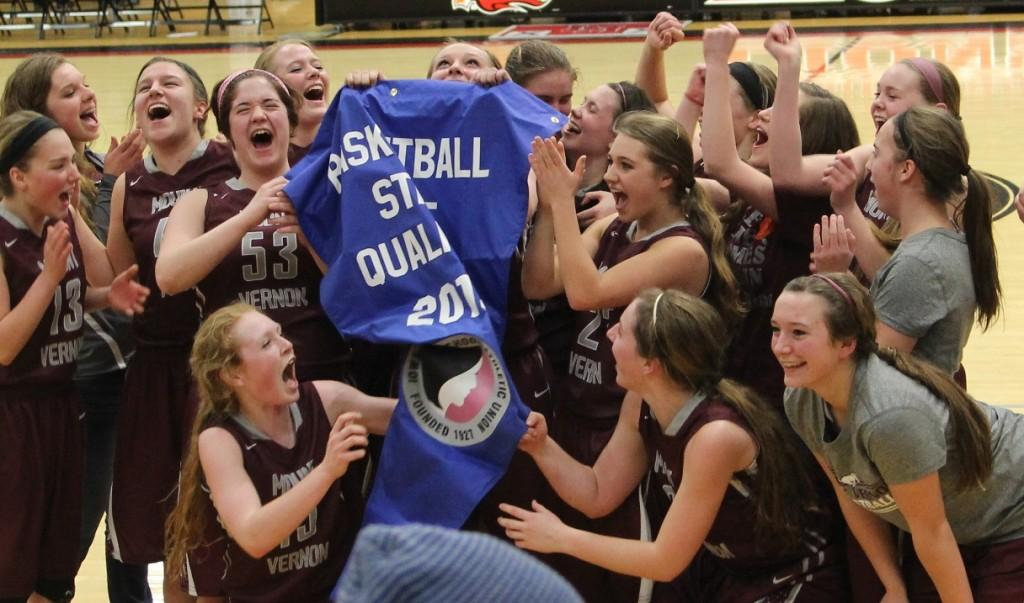 The team celebrates with the banner. Photo by Lexi Kelly.