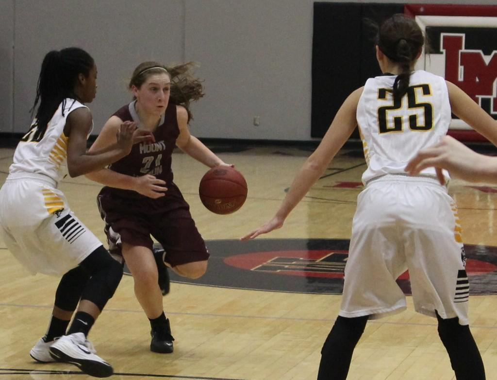 Libby Ryan maneuvers between CPU's LaMia Sisk and Olivia Brecht in the second quarter. The score was 30-18, CPU's lead. Photo by Lexi Kelly.