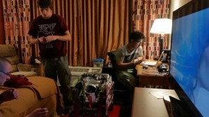 Nathaniel Barnhart and Orgho Neogi stay up late to program the robot March 27. Photo by Richard Scearce.