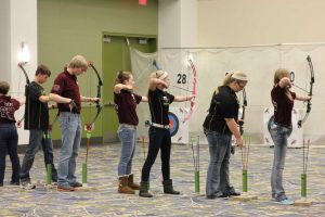 Mount Vernon's Isaiah Exley-Schuman and Emily Friedman shoot at state March 7. Emily tied for 4th place for the team with a score of 279. Photo by Lexi Kelly