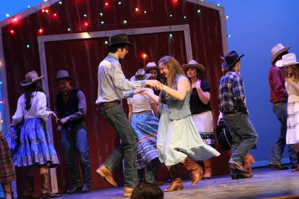 Cowboy Bob (junior Chris Cripe) dances with Rusty (junior Hannah Clark).