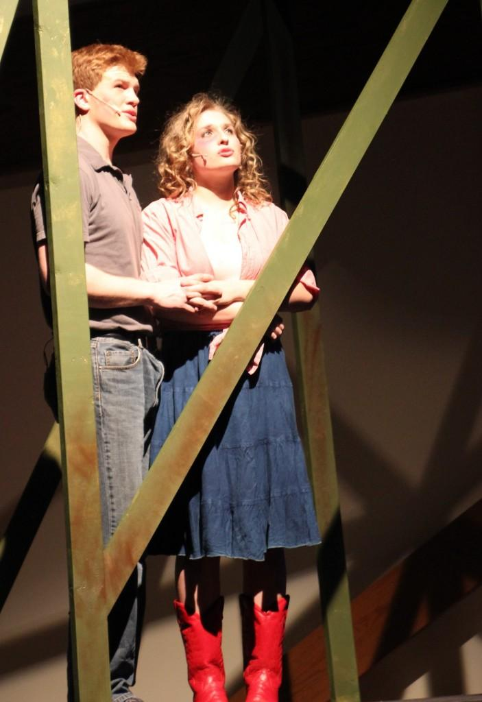 """Bryce Cox and Jenna Reimann sing """"Almost Paradise"""" at dress rehearsal April 10."""
