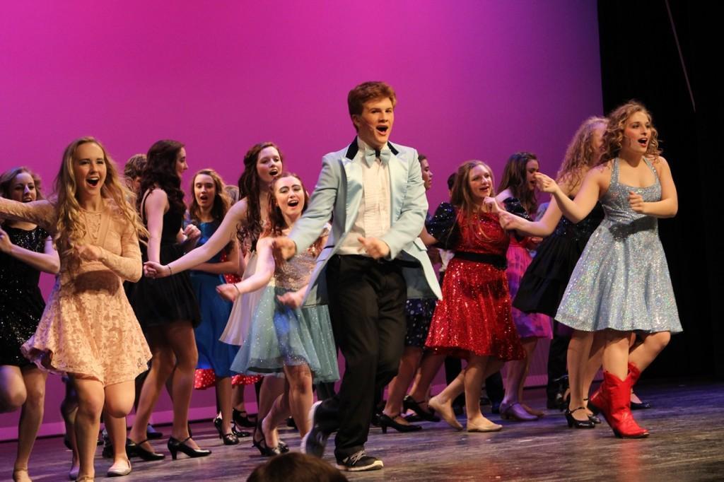 Ren McCormack (junior Bryce Cox) and Ariel Moore (junior Jenna Reimann) dance at prom.