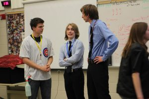 "Luke Moran, Sam Krapfl, and Simon Crocker take on the roles of Social Studies teacher Ed Timm, Activities Director Matt Thede, and Principal Steve Brand in The Dramatic Interpretation of Literature  play ""Ides of May."" Performances were April 7-8. Photo by Kelsey Shady."