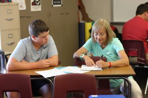 In her Spanish 2 class, Mrs. Deibner helps freshman Reece Pitlik. On Aug 27 her class learned new Spanish vocab.