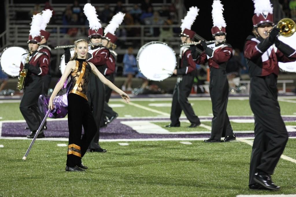 Color guard member Rebecca Edwards performs with the band Sept. 11. Photo by Sam White.