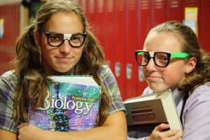 Freshmen Sydney Hauser and Sam White dress as some cute geeks on jocks vs. geeks day for homecoming. Student council is attempting to get more participation this year by offering prizes.
