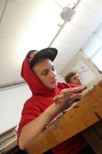 Freshman Aiden Frantz creates a picture in a beginning drawing class on Aug 27