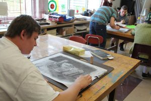 During a Beginning Drawing class on Aug. 27, sophomore Cameron Ling uses shading techniques and charcoals to create a drawing of wooden blocks.