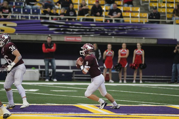 Sophomore quarterback Drew Adams completed 21 of 31 passes making 2A records of 387 passing yards and six touchdowns. Photo/Bailey Priborsky