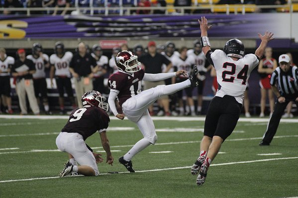 Carlos Castro Reyes kicks for an extra point. Reyes made three successful XPs in the game.