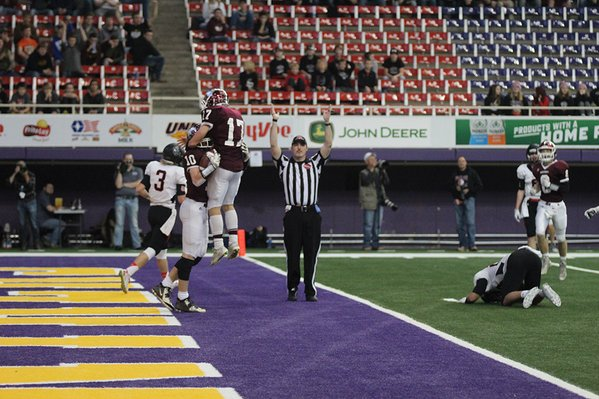 Jack Cochrane and Joe Corcoran celebrate one of Cochrane's touchdowns. Cochrane received three passes for a total of 50 yards.