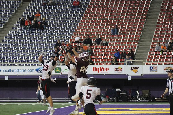 Connor Herrmann tips the ball, then catches it with one hand for a touchdown around Spirit Lake's  Cory Meschede (#23) and Logan Backhaus (10). Photo/Bailey Priborsky