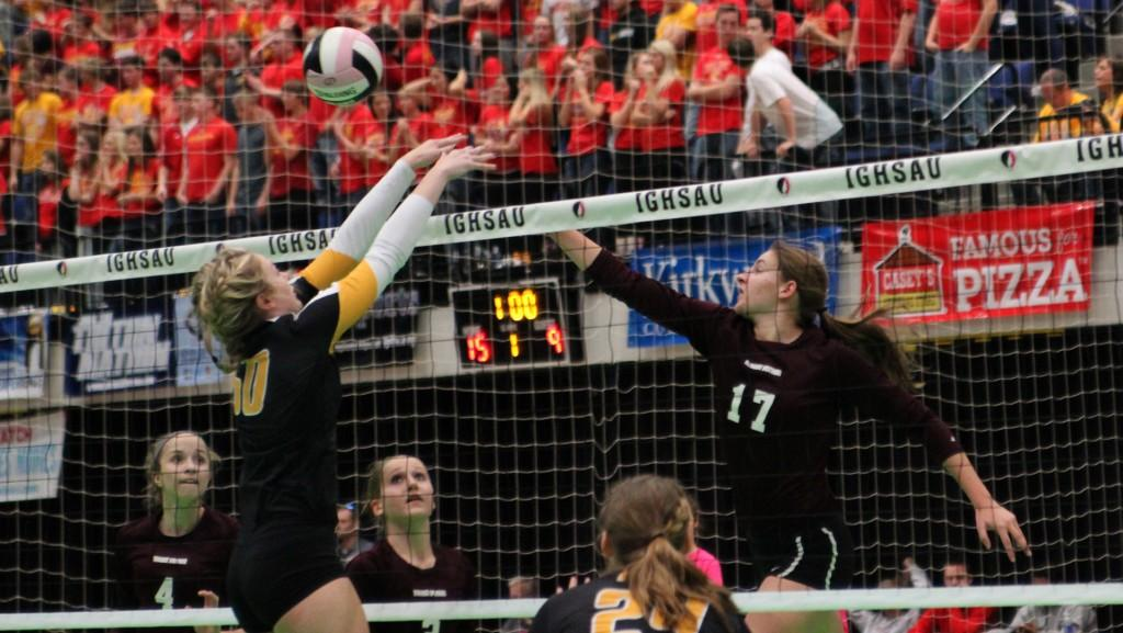 Kaitlyn Volesky spikes the ball in the first set against CPU in 3A state quarterfinals Nov. 11. The Mustangs lost the first set, 26-24, but won the match 3-1. Photo by Maggie Rechkemmer.