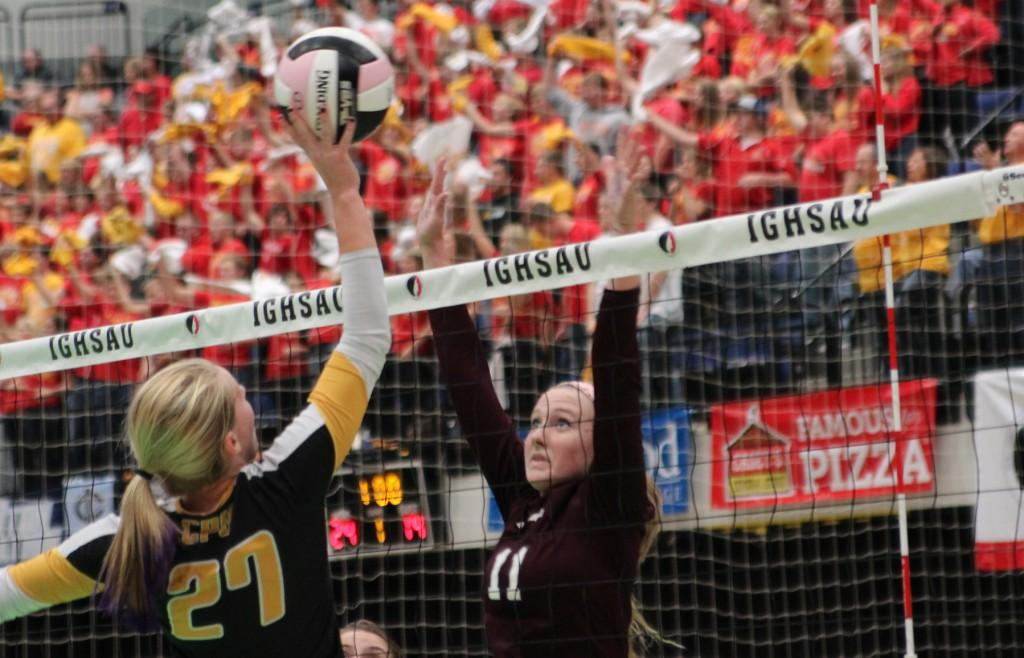 Wynne Vandersall goes up for the block. Photo/ Maggie Rechkemmer.