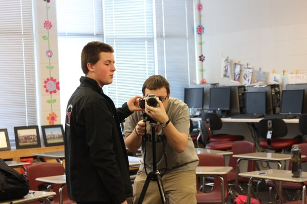 Matt Morrical and Alex Moore learn to use the camera and tripod on the first day of their video journalism class taught by journalism teacher JoAnn Gage.