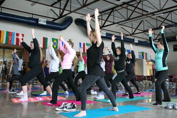 Exercise Science class practices yoga with Christine Davis Jan. 7. Photo/Catherine Yeoman.
