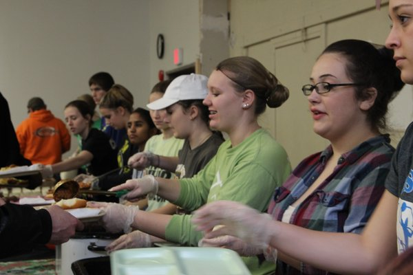 The Social Justice class taught by Leigh Ann Erickson and Shawn Voigt serves food at Mission of Hope in Iowa City Jan 5. See KCRG's story about the field trip: http://www.kcrg.com/content/news/High-School-Course-Takes-Students-Out-of-their-Comfort-Zone-364580611.html … Photo/Grace McCollum.
