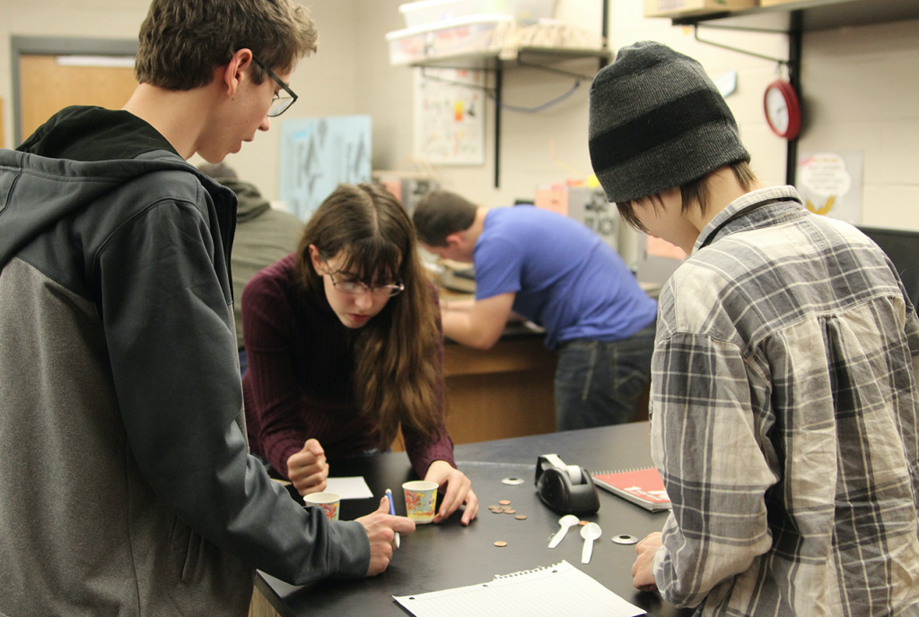 Students in Popular Science Chemistry with Mrs. Appley conduct an experiment. Photo by Grace McCollum.