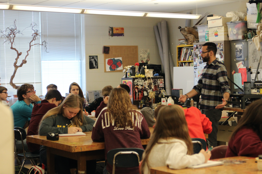Freshmen study Recent U.S. HIstory with Art teacher Ely Sotillo. The class interviewed adults about their memories of 9/11. Photo/Grace McCollum.