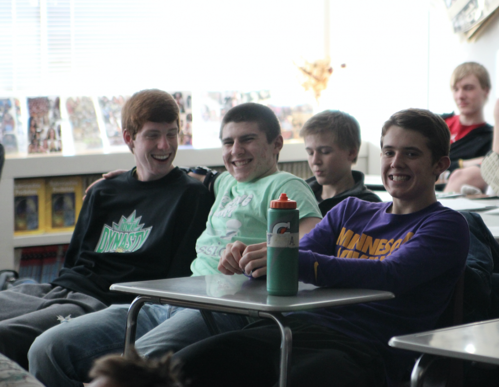 Sophomores Garrett Welch, Colden Clark, and Drew Adams are excited to learn about the Cold War through James Bond movies taught by Maggie Willems and Scott Weber. Photo/Macy Griebel.