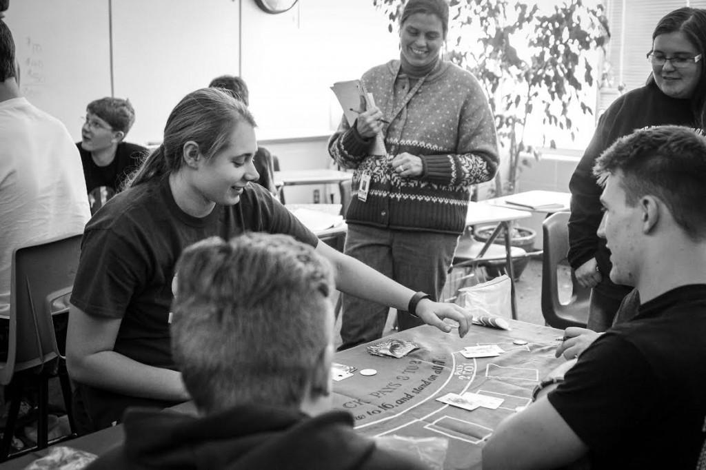 """The """"Are You Game?"""" class play's blackjack to learn about probability Jan. 5.  The class is taught by Mary Young and Beth McCollum. Photo/Colin Cross"""