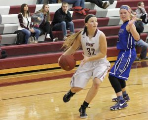 Sophomore Kristen Elliott looks for a shot against the Comets in round one of districts. Mount Vernon beat West Liberty, 66-47. Photo by Alyssa Maddocks.
