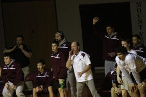 Coach Vance Light cheers on a wrestler Feb. 8 in the Regional Final against Assumption. Photo/Kelsey Shady.