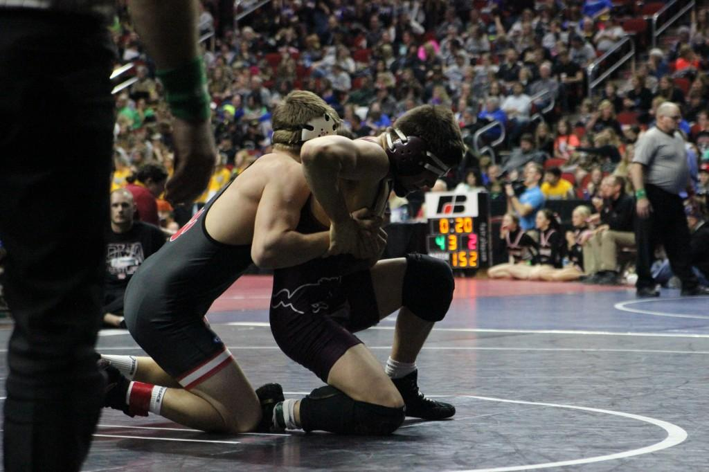 Senior John Engelbrecht fights off Zach Johnson of ADM. Engelbrecht wins by decision 11-4.  Photo: Jessika Brokel