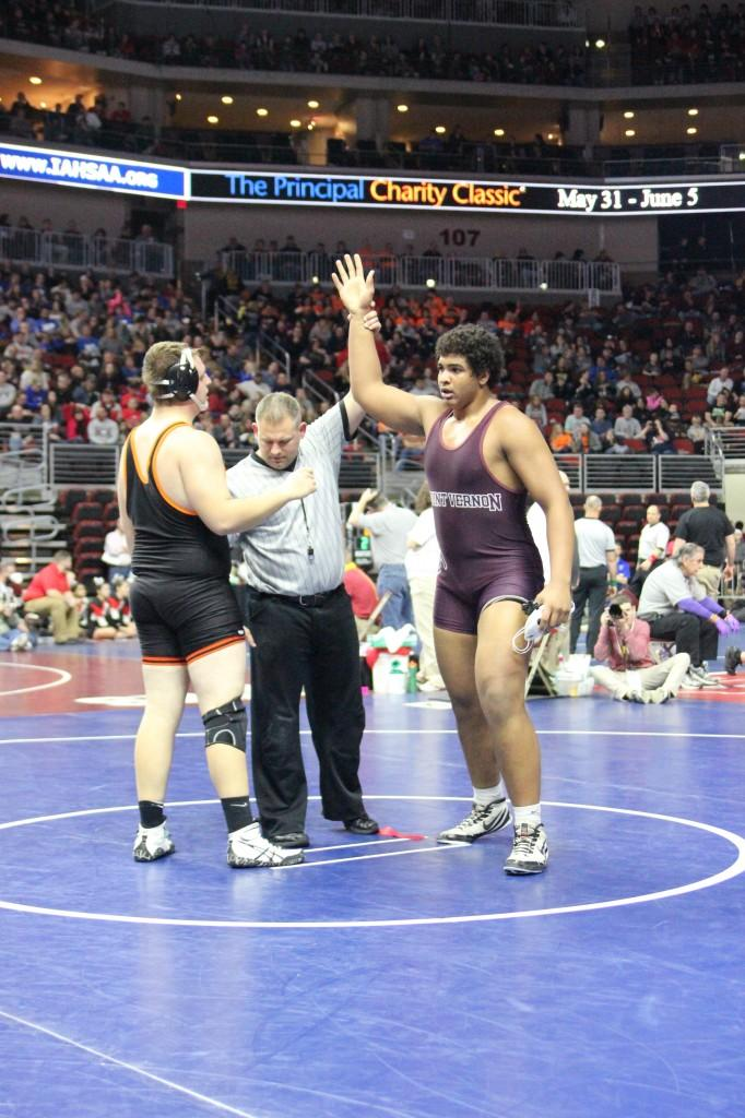 Junior Tristan Wirfs gets his hand raised after defeating Brody Tupy from Charles City.   Photo: Jessika Brokel