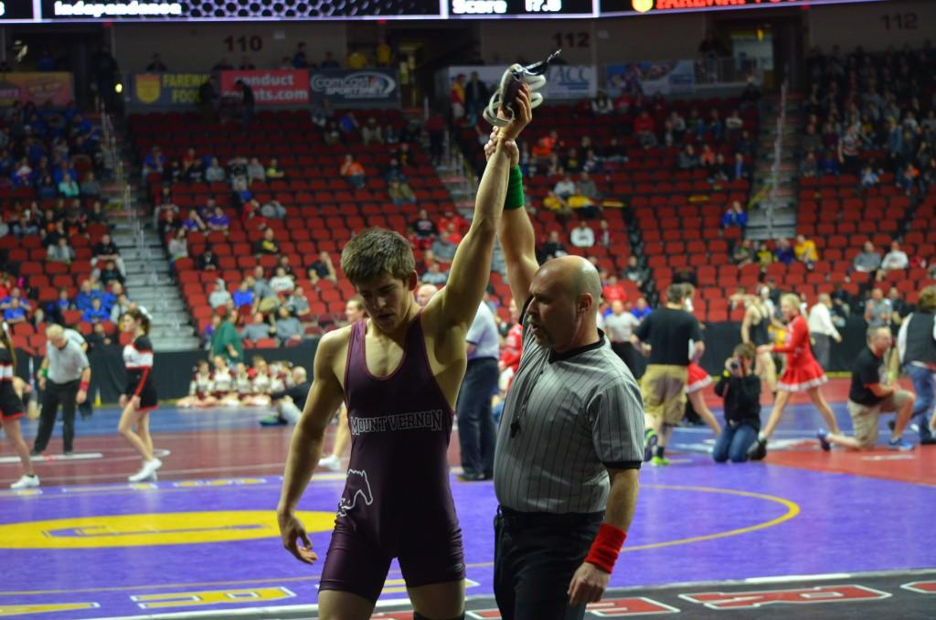 Senior John Engelbrecht gets his hand raised after defeating  Harlans J. Wingert to win his second cancellation round.  Photo: Kelsey Shady