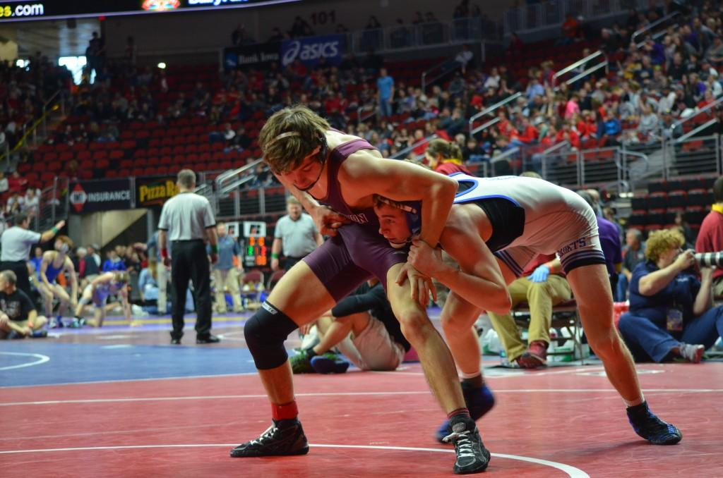 Tony Garcia, junior, wrestles Derek Holschlag of Union- LaPorte City in his quarterfinal match. Holschlag won by decision 3-9.   Photo: Kelsey Shady