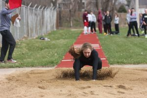 Landing her jump, junior LIbby Ryan finishes her event at Cornell on March 26