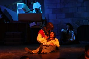 In battle, Eponine dresses up as a student and fights. She is shot and dies in Marius' arms.