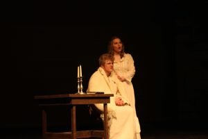 Meanwhile, Fantene has come down from heaven and is urging Valjean to let go and come back with her.