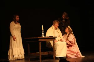 Marius and Cosette arrive and Cosette cries to her father, wanting him to stay.