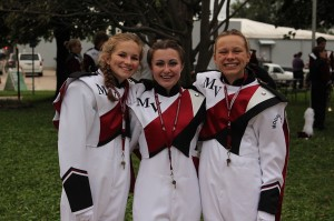 Drum majors Tori Steiner, Chelsea Wallace, and Quinnie Rodman pose before their performance at the football game Sept. 16. Photo by Paige Zaruba.
