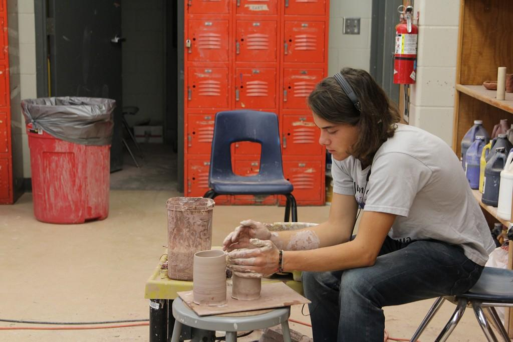 In Ceramics, Junior Aleck Krob spends his first block day making a cylinder pot. Photo By: Summer Everhart