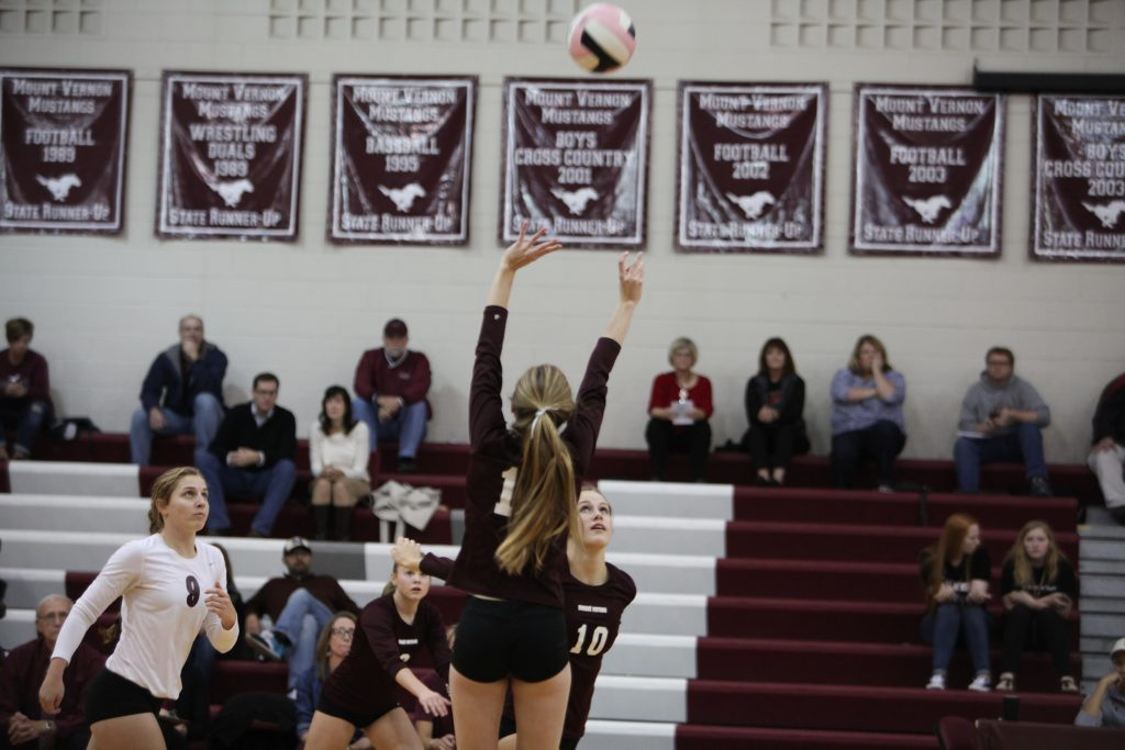 Sophomore Ella Brase sets the ball for senior Katie Wycoff on Oct 25.