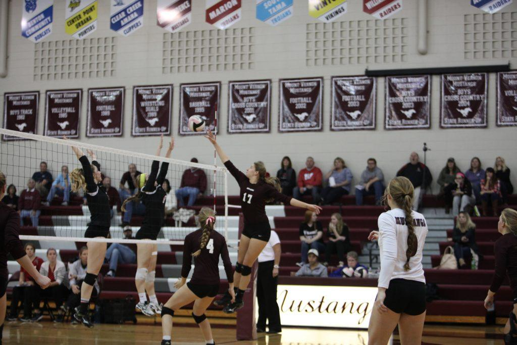Kaitlyn Volesky reaches to tip the ball over the net against Williamsburg.