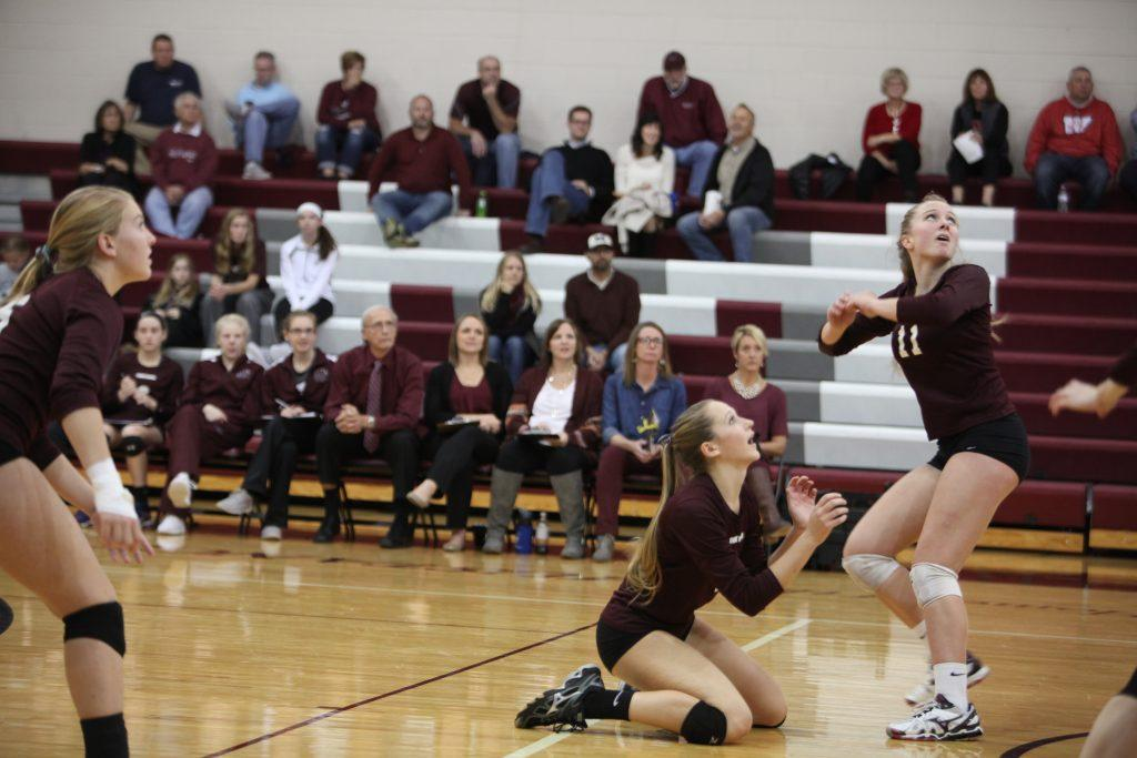 Grace Pettinger, Sydney Meeker, and Wynne Vandersall anxiously watch the ball on Oct 25.