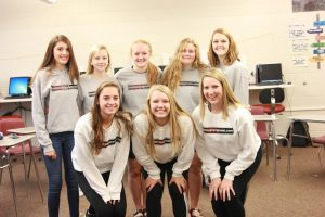 Posing in the new publication sweatshirts the editing staff celebrates 20 years of work. Front Row: Sydney Hauser, Jessie Brokel, Rachel Bell. Back Row: Maggie Dale, Bailey Priborsky, Alyssa Maddocks, Emma Klinkhammer, and Kelsey Shady.