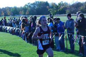 Senior, Liam Conroy, runs towards the finish lines at the district meet on Oct. 20.